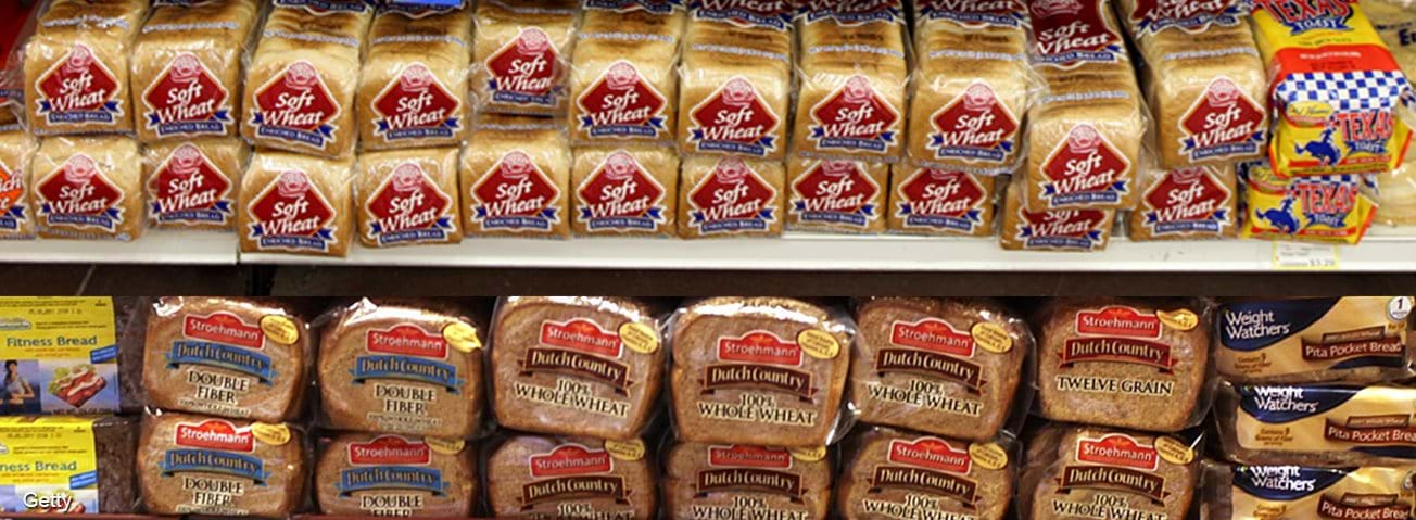 Wheat bread packages on shelves in grocery store