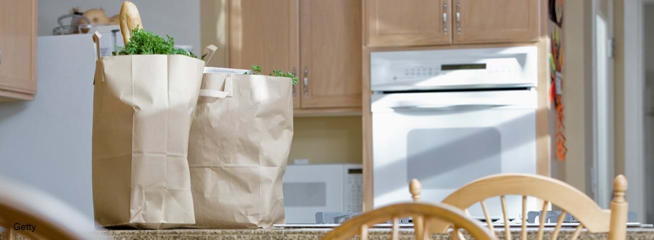 Grocery bags sitting on kitchen counter