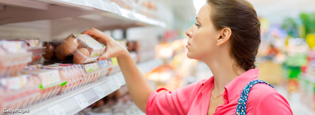 Woman looking at eggs in grocery store
